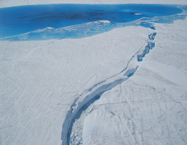Greenland's Ice Sheet is undergoing massive changes, including melted lakes on the surface and holes in the overflow channel leading to a moulin, a crevasse through which water enters a glacier bed from the surface. Photo: Science