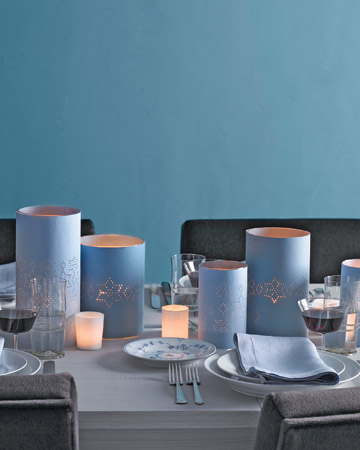Hurricane vases and votive candle holders can be wrapped in star-punched paper in the color of your choice -- an easy way to suffuse your party with warmth.