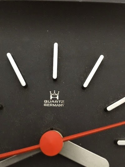 vintage black plastic wall clock face detail