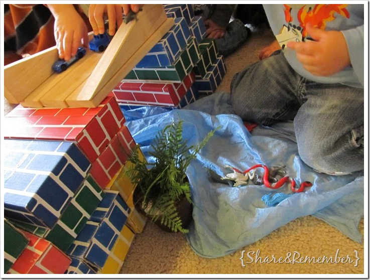 kids building a bridge with cardboard and wood blocks