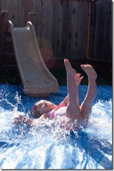 Slide + Tarp + Water Hose = Slipping Sliding Fun!
