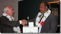 Spencer J. Condie presents 28 rolls of microfilm to the government of Niue