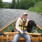 River tours and guided fishing are available at the lodge. Here our daughter-in-law is on the river with her dog Codie.
