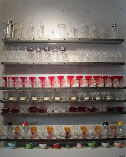 This wall of glasses and teacups is very pretty.