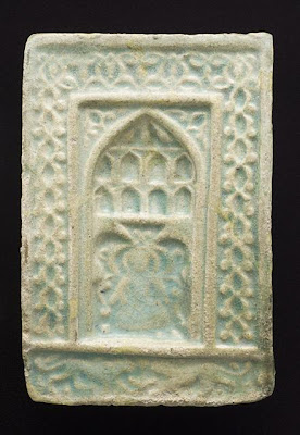 Tile | Origin: Greater Iran or Turkey | Period:  second half of 13th to 14th century | Collection: The Madina Collection of Islamic Art, gift of Camilla Chandler Frost (M.2002.1.223) | Type: Ceramic; Architectural element, Fritware, molded, and glazed, 9 1/4 x 6 1/8 in. (23.49 x 15.55 cm)
