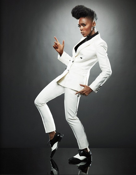 Janelle Monáe wearing a cool white suit and dandy shoes