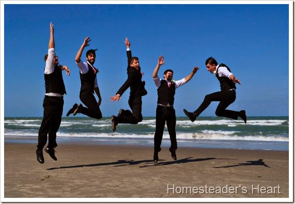 boys jumping beach