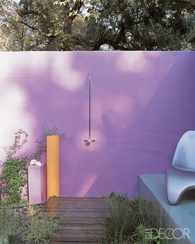 An outdoor space is somewhere you can really have some design fun. Painting an outside wall or patio a vibrant color like this one will electrify your outside living.
