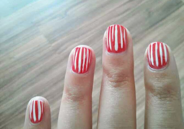 summer mani nail design coral with white stripes