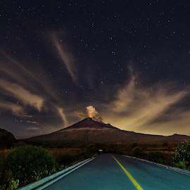 Smoking volcano at night by Cristobal Garciaferro Rubio - Landscapes Travel ( popo, mexico, puebla, popocatepetl, road, nightscape )