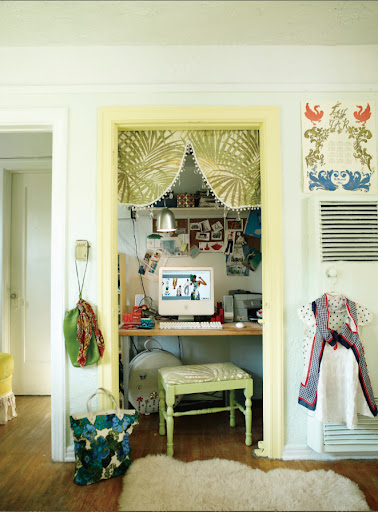 I really like the idea of tucking a small office into a closet.  It's such a space saver.  The bright yellow trim and vintage fabric are fun touches.