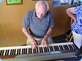 Rob Powell having a practice on the Korg SP 250 digital piano (ready for playing at Piha next month on Coffee Day).