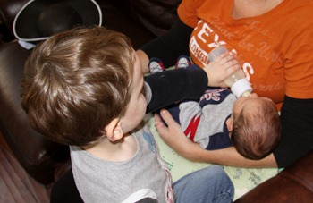 Braden giving Graham bottle - Oct 2011 (1)