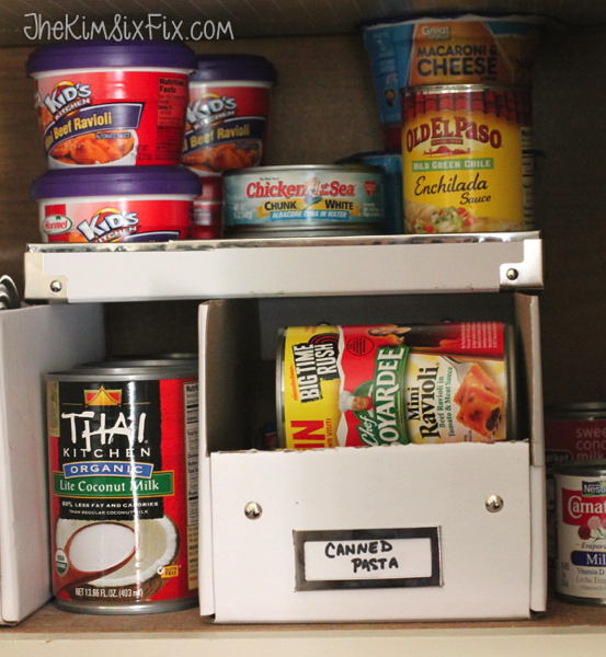 Organizing cans in pantry