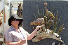 1403090 Mar 14 Barb With Blue Heron Sculpture