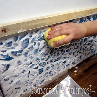 Wiping off your grout ~ Installing a mosaic backsplash! {Sawdust and Embryos}