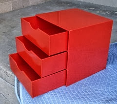 red acrylic cube drawers open