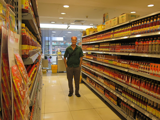 An entire row of hot sauces from around the world at Mustafa Centre.