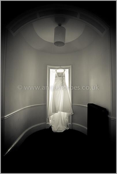 Brides dress at window, carberry tower, edinburgh