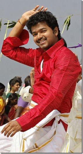 vijay-velayutham-stills-with-red-color-dress