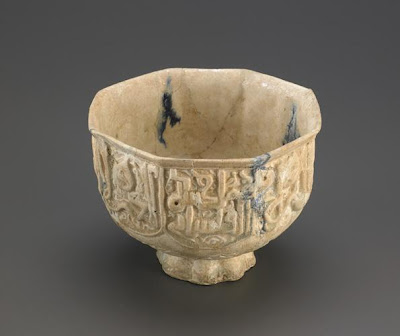 Octagonal bowl | Origin:  Iran | Period: late 12th century  Hasan al-Kashani,Saljuq period | Details:  Not Available | Type: Stone-paste; molded decoration under transparent glaze with blue splashes | Size: H: 11.7  W: 15.2  cm | Museum Code: F1955.9 | Photograph and description taken from Freer and the Sackler (Smithsonian) Museums.