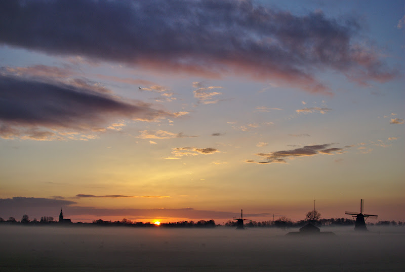 Sunrise over the Kinderijk polder on Holland.