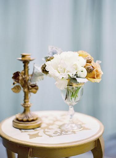 Gold-rimmed crystal goblets adorned accent tables.