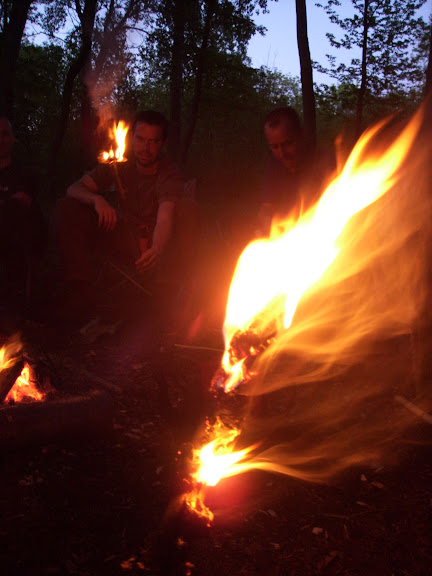 Birch bark torches at dusk.