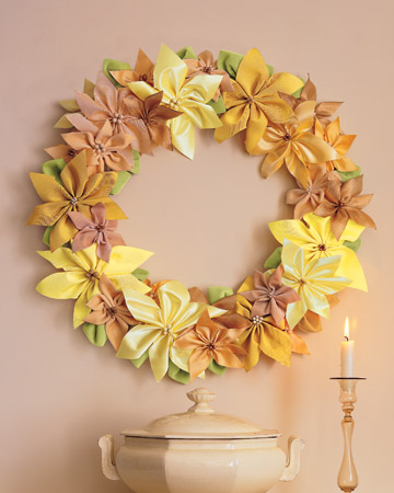 Brighten your walls with a wreath made of golden-hued ribbons fashioned into poinsettias.