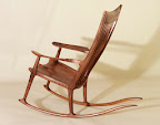 Organically sculpted rocking chair made from walnut