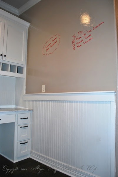 Mudroom beadboard wall with dry erase paint area above