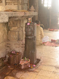 This ekmukhi linga is standing without pitha (pedestal). It is not clear whether this lingam was installed in later period as the position is little awkward. This ekmukhi lingam is facing north, so this face should represent the Vamadeva aspect of Shiva.