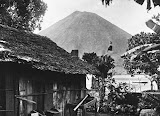The yard of a house and Gunung Api (unknown photographer, 1905-1914) Courtesy TropenMuseum Archives