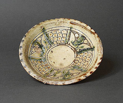 Dish Afghanistan Dish, 9th-10th century Ceramic; Vessel, Earthenware, with incised slip and color under transparent glaze, Height: 1 3/8 in. (3.49 cm); Diameter: 6 5/16 in. (16.03 cm) Gift of Andrew Hale and Kate Fitz Gibbon (AC1992.213.4) Art of the Middle East: Islamic Department.