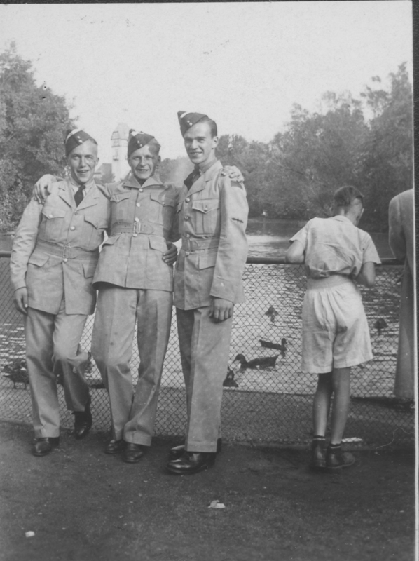 Three servicemen of the #3 wireless school relax at Tuxedo Park. August 1942.