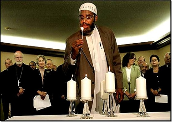 CV --   Brookline, MA., 09/11/06,  Interreligious leader and representatives in Massachusetts gathered together at the Greek diocesan headquarters to mark the fifth anniversary of 9/11. Prayers were said and candles were lit in remembrance.  Imam Abdullah Faaruuq, cq,  representing the Islamic Council of New England lit a candle.  Section: Metro, Reporter: Paulsen. Suzanne Kreiter/Globe staff.