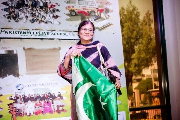 Mam Farzana holding flag