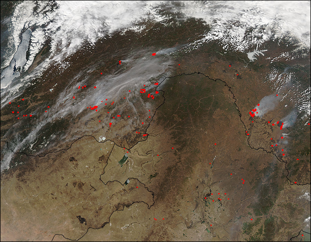 NASA LANCE MODIS Rapid Fire hotspot analysis of extreme fire outbreak in the Amur region of Russia on 28 April 2014. In this shot, the Amur runs west to east through the frame. To the right is the Pacific Ocean [off frame] to the left is a corner of Russia's massive Lake Baikal. The red spots indicate currently active fires. Photo: NASA LANCE-MODIS