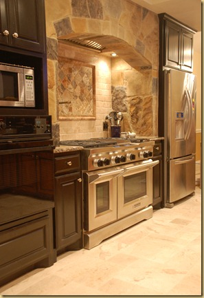 Black cabinets Stone arch Stainless range
