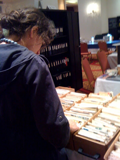 here is Corinne looking through boxes of envelopes - each envelope boasts original stamps from the original date of issue.