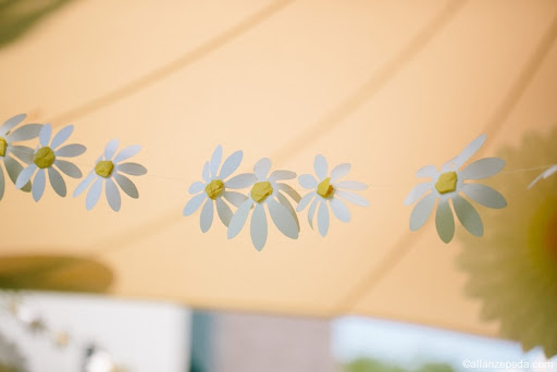 I made this garland from paper daisies (in the sale) and used yellow tissue paper for the center and threaded on monofilament. 