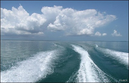 clouds in wake from boat