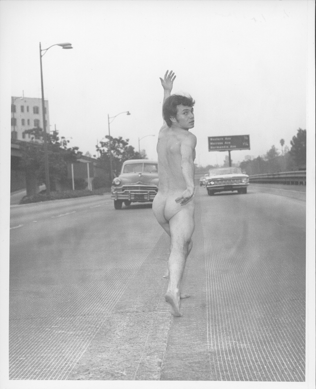 "A still from Pat Rocco's short film, ""A Breath of Love."" Brian Reynolds, pseudonym Chuck Robinson,  poses nude on the Hollywood Freeway. Circa 1969."