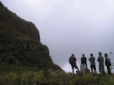 Hikers admire the view from the boundary marker at the col below Kelud cliffs (Daniel Quinn, February 2011)