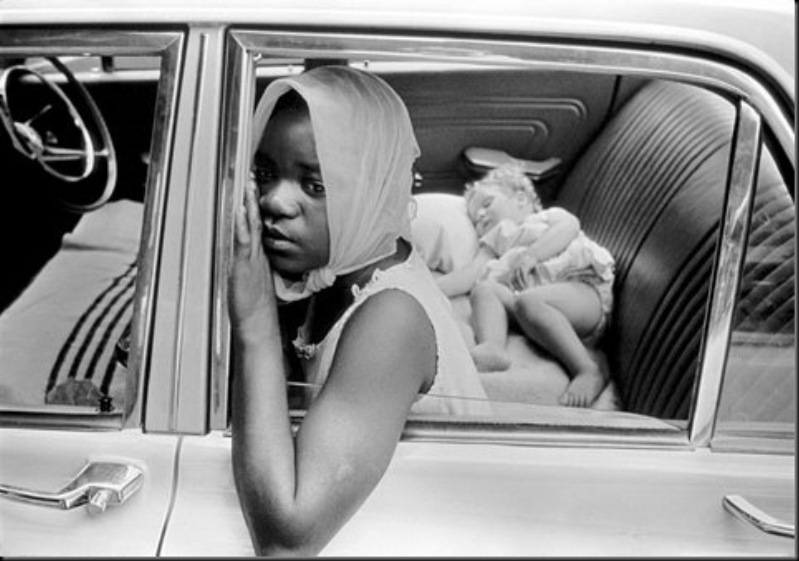 SOUTH AFRICA — A black woman looks after a white child, 1969.