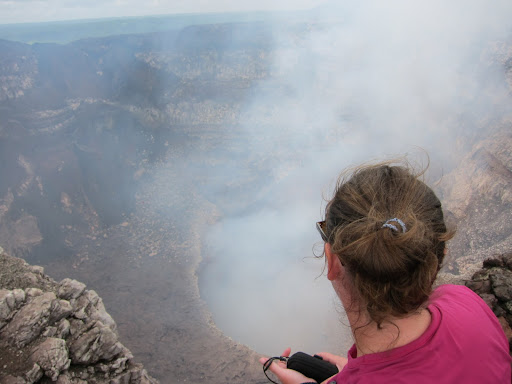 Heather on the edge of the crater, Volcan Masaya, Nicaragua