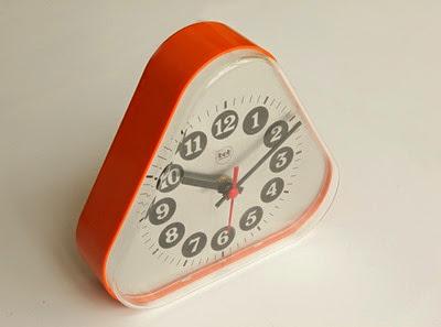 orange bob wall or desk clock top