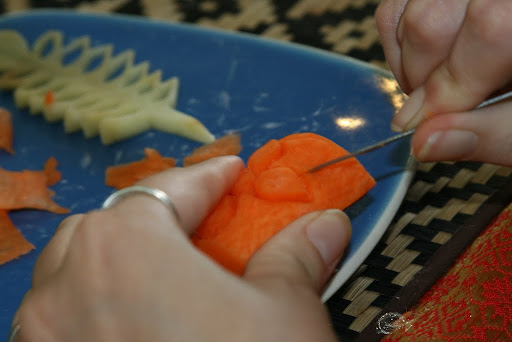 Lynette working on her own carrot Lotus.