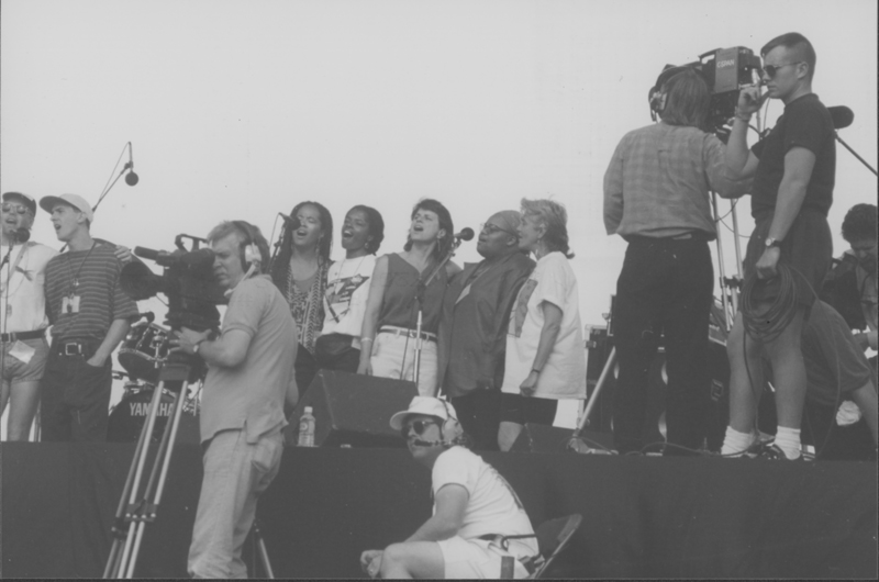 Lesbian singer Cris Williamson (close right at microphone) sings with others on the main stage at the March on Washington. 1993.