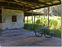 Picnic table next to stalls